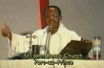 887048845-Jean-Bertrand-Aristide-preaching-St_-John-Bosco-prior-to-1990