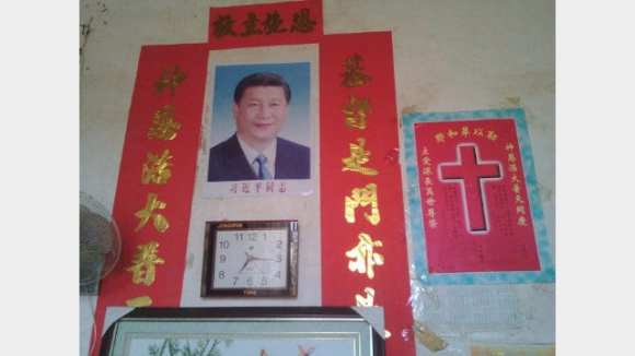 A-portrait-of-Xi-Jinping-put-up-in-the-home-of-a-Christian.